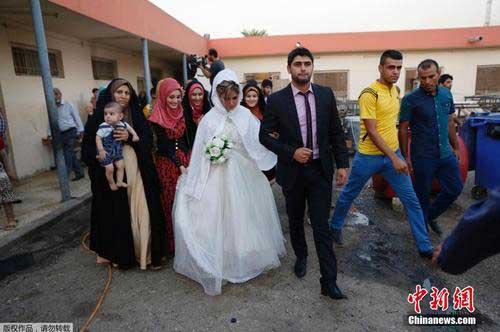 伊拉克什叶派小伙迎娶逊尼派美女组图